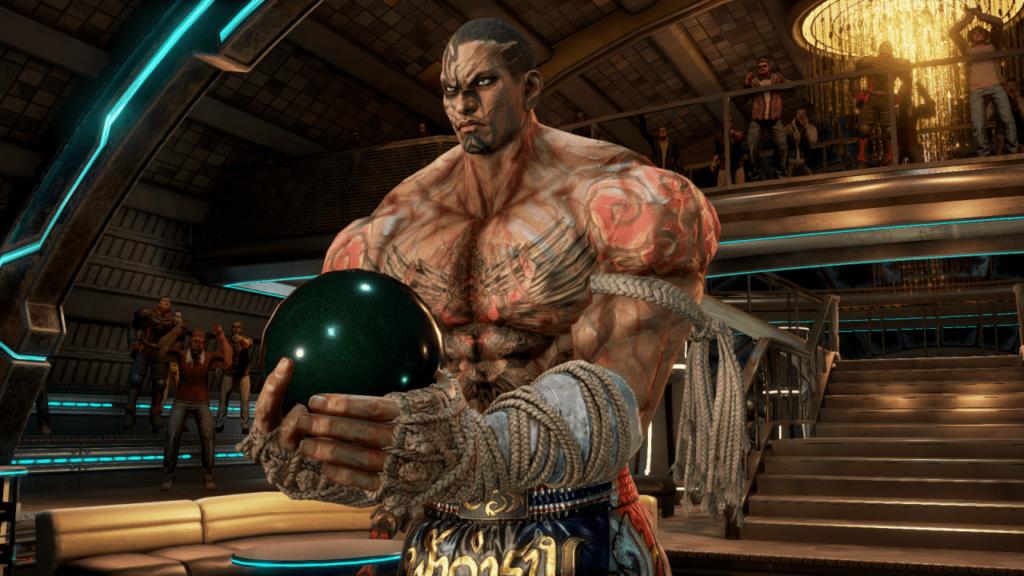 Le personnage de Tekken 7 Fahkumram portant une boule à deux mains lors de la sortie de la mise à jour 3.30