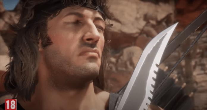 Le visage de John Rambo avec son couteau dans sa bande-annonce de Gameplay pour Mortal Kombat 11: Ultimate