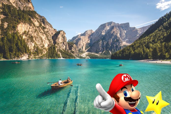 un lagon avec des bateaux dessus et Mario qui pointe du doigt avec une étoile